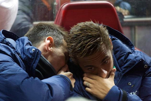 Barcelona's Messi and Neymar cover their mouths as they talk on the bench before their Spanish first division soccer match against Atletico Madrid at Vicente Calderon stadium in Madrid