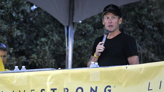 Lance Armstrong speaks at the Livestrong Challenge Austin bike ride Sunday, Oct. 21, 2012, in Austin, Texas. Lance Armstrong greeted about 4,300 cyclists at his Livestrong charity's fund-raising bike ride, then retreated into privacy as cycling officials