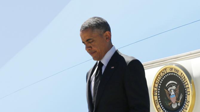 U.S. President Obama disembarks from Air Force One as he arrives at Los Angeles International Airport