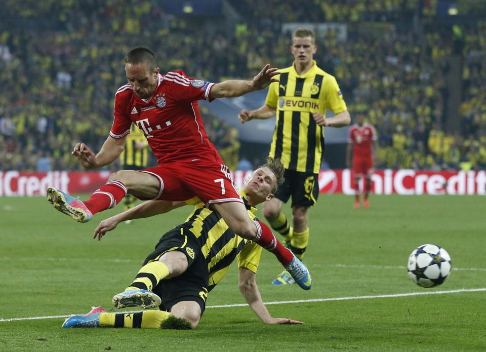 Bayern's Franck Ribery of France, foreground, in action, during the Champions League Final soccer match between Borussia Dortmund and Bayern Munich at Wembley Stadium in London, Saturday May 25, 2013.  (AP Photo/Matt Dunham)
