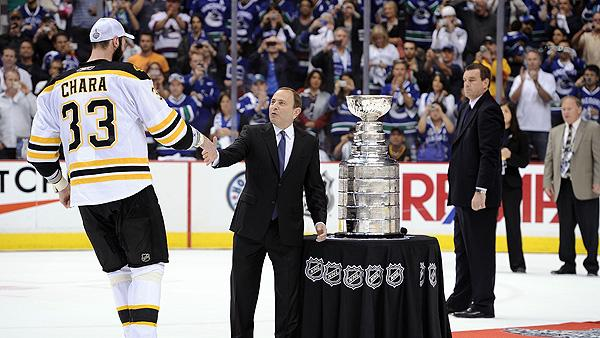 NHL commissioner Gary Bettman congratulates Boston Bruins' Zdeno Chara on winning the Stanley Cup in 2011