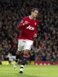 Manchester United's Javier Hernandez celebrates after scoring against Newcastle United during their English Premier League soccer match at Old Trafford Stadium, Manchester, England, Saturday Nov. 26, 2011. (AP Photo/Jon Super)