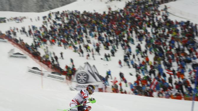 Hirscher of Austria clears a gate during the men's Alpine Skiing World Cup Slalom race in Kitzbuehel