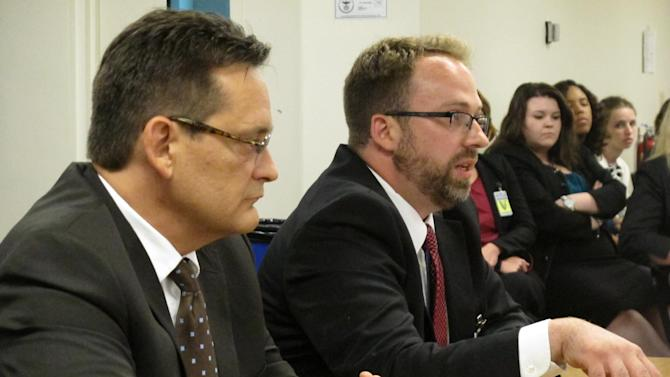 In this photo taken Monday, July 8, 2013, Assistant Cuyahoga County Prosecutor Matthew Meyer, right, explains to the Ohio Parole Board why his office is recommending that condemned killer Billy Slagle's death sentence be commuted to life without parole, as fellow Cuyahoga County prosecutor Allan Regas listens, in Columbus, Ohio. Meyer's boss, Cuyahoga County Prosecutor Tim McGinty, wants capital punishment cases to be the exception in his office, not the rule. (AP Photo/Andrew Welsh-Huggins)