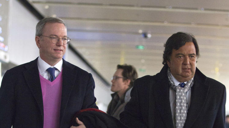 Google executive chairman Eric Schmidt, left, and former New Mexico Gov. Bill Richards walk out an entrance after they arrived at Beijing Capital International Airport from Pyongyang, in Beijing Thursday, Jan. 10, 2013. Schmidt is urging North Korea to shed its self-imposed isolation and allow its citizens to use the Internet or risk being left behind economically. (AP Photo/Alexander F. Yuan)