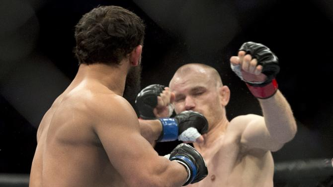Johny Hendricks, from Dallas, knocks out Martin Kampmann, from Las Vegas , during the first round of their UFC welterweight fight Sunday, Nov. 18, 2012 in Montreal. (AP Photo/The Canadian Press, Ryan Remiorz)