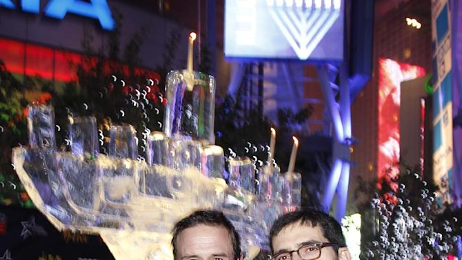 IMAGE DISTRIBUTED FOR AEG - David Arquette, left, and Chaim Marcus seen at AEG Season of Giving celebrates Chanukah with David Arquette and Chabad's Rabbi Cunin on Sunday, Dec. 9, 2012 in Los Angeles. (Photo by Joe Kohen/Invision for AEG/AP Images)
