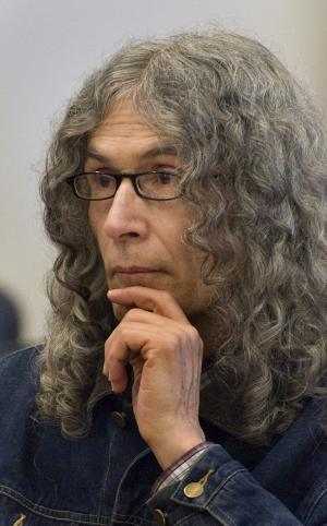 """FILE - In this March 30, 2010 file photo, convicted serial killer Rodney Alcala listens as victim-impact statements are read in a Santa Ana, Calif. On Wednesday, June. 20, 2012, Alcala was headed to New York to face charges of killing two young women, Cornelia Crilley and Ellen Hover, in the 1970s, the Manhattan district attorney's office said. Alcala, a photographer and former """"Dating Game"""" contestant, has been on death row in California for the 1970s stranglings of four women and a 12-year-old girl. (AP Photo/Michael Goulding, Pool, File)"""
