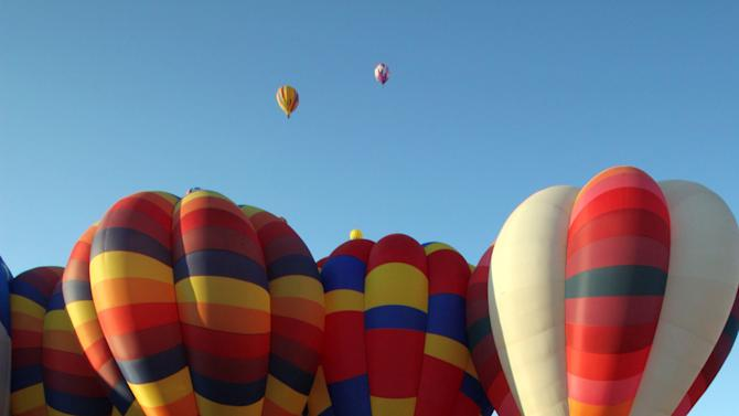 Hot air balloons inflate during the mass ascension at the Albuquerque International Balloon Fiesta in Albuquerque, N.M., on Saturday, Oct. 2, 2010. About 500 balloons were registered for the annual event. (AP Photo/Susan Montoya Bryan)