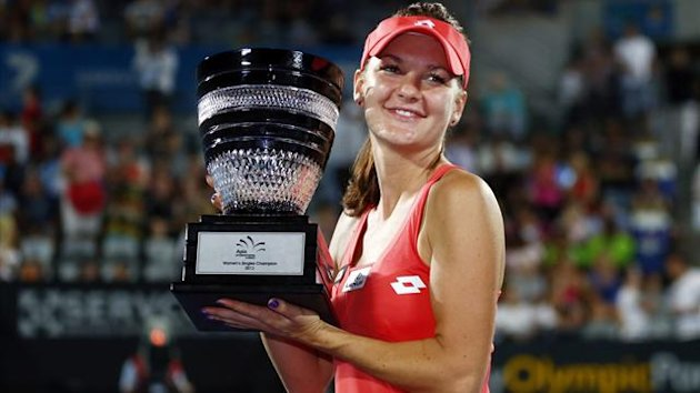 Agnieszka Radwanska of Poland poses with the trophy after defeating Dominika Cibulkova