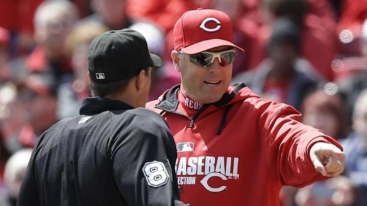 Cincinnati Reds manager Bryan Price argues a call with home plate umpire Quinn Wolcott (81) in the fifth inning of a baseball game against the Pittsburgh Pirates, Wednesday, April 16, 2014, in Cincinnati. Cincinnati won 4-0
