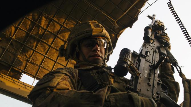 A U.S. soldier from Grim Company of the 3rd Cavalry Regiment removes a machine gun from its mount near Forward Operating Base Fenty in the Nangarhar province of Afghanistan