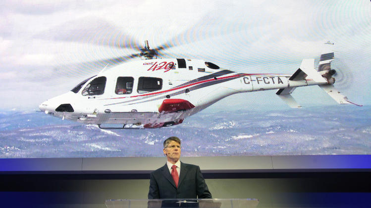 IMAGE DISTRIBUTED FOR BELL HELICOPTERS - Bell Helicopter President and CEO John Garrison delivers his opening address at HELI-EXPO 2013 on March 5, 2013 in Las Vegas. Garrison announced a landmark 30 helicopter deal with Air Medical Holdings Group, one of the largest orders in recent HELI-EXPO history. (David Becker/AP Images for Bell Helicopters)
