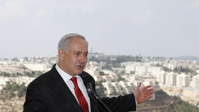 Israeli Prime Minister Benjamin Netanyahu gestures as he speaks to journalists during his visit to the east Jerusalem Jewish neighborhood of Gilo, Tuesday, Oct. 23, 2012. Netanyahu vowed on Tuesday to continue building in the Jerusalem district days after European Union criticism because it is claimed by Palestinians. (AP Photo/Gali Tibbon, Pool)