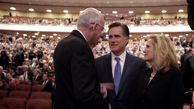 FILE - In this Saturday, Feb. 2, 2008 photo released by The Church of Jesus Christ of Latter-day Saints, Republican presidential candidate Mitt Romney, right, and his wife Ann, right, greet Utah Sen. Bob Bennett, left, during the funeral service of Gordon B. Hinckley, president of the Mormon church, in Salt Lake City.  Hinckley died Sunday. He was 97.How unthinkable it was, not so long ago, that a presidential election would pit a candidate fathered by an African against another condemned as un-Christian. And yet, here it is: Barack Obama vs. Mitt Romney, an African-American and a white Mormon, representatives of two groups and that have endured oppression to carve out a place in the United States. How much progress has America made against bigotry? (AP Photo/The Church of Jesus Christ of Latter-day Saints, Pool)
