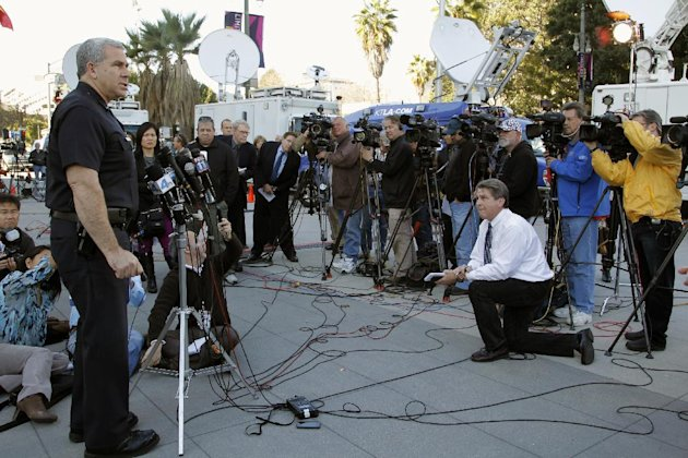 Los Angeles police Lt. Andrew Neiman, left, takes questions from the media at news conference about conviction of former police officer Christopher Jordan Dorner, outside the LAPD headquarters downtow
