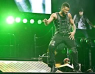"FILE - In this Feb. 2, 2011 file photo, Usher performs at the o2 arena in London. Usher, who had electronic-flavored successes with the will.i.am-produced ""OMG,"" ""DJ Got Us Fallin' In Love Again"" and David Guetta's ""Without You,"" says his new album will blend electronic and soul, and will feature Swedish House Mafia, Diplo, Klas Ahlund (the main producer behind Robyn), and Luke Steele of the Australian electronic duo Empire of the Sun. (AP Photo/Joel Ryan, file)"