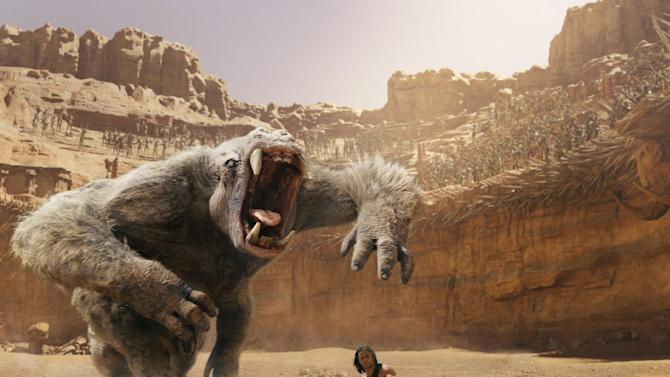 "In this film image released by Disney, Taylor Kitsch is shown in a scene from ""John Carter."" (AP Photo/Disney)"