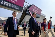 "British Prime Minister David Cameron (second left ) and London Olympics organiser Sebastian Coe (left) at Stratford Station by the Olympic Park in London on July 26. Cameron on Thursday downplayed a mix-up which saw North Korea's female football team walk off the pitch in an embarrassing start to the London Olympics, calling the blunder ""an honest mistake"""