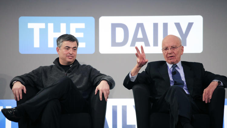FILE - In this Wednesday, Feb. 2, 2011, file photo, Rupert Murdoch, right, Chairman and CEO of News Corporation, and Eddy Cue, vice president of Apple, attend the launch of The Daily,  in New York. News Corp. said it will cease publication of The Daily, on Dec. 15, 2012.  News Corp. had hoped The Daily would lure both paying subscribers and advertisers to a digital newspaper that included news, gossip and opinion. (AP Photo/Mark Lennihan)