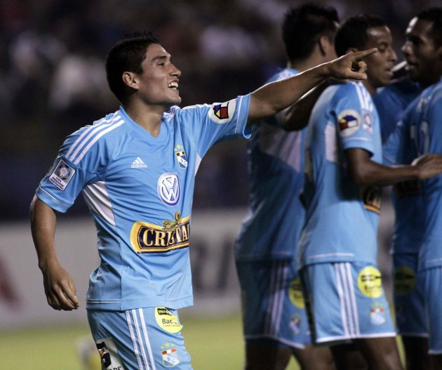 Irven Avila of Peru's Sporting Cristal celebrates after scoring against Paraguay's Libertad during their Libertadores Cup soccer match in Asuncion