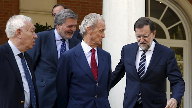 Rajoy arrives for a cabinet group photo at Moncloa palace in Madrid