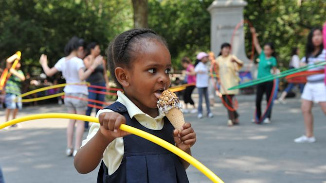 COMMERCIAL IMAGE - In this photograph taken by AP Images for Nestle Drumstick, Amera Nelson, 2, of Brooklyn, enjoys a free Nestle Drumstick cone in celebration of the first day of summer, Wednesday, June 20, 2012, in New York.   (Diane Bondareff/AP Images for Nestle Drumstick)