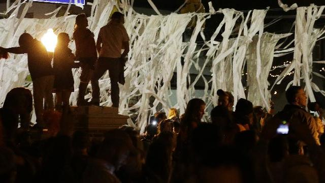 Auburn fans roll Toomer's Corner following their 34-28 win over No. 1 Alabama in an NCAA college football game in Auburn, Ala., Saturday, Nov. 30, 2013