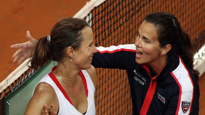 United States' Varvara Lepchenko left, is congratulated by her team captain Marie Joe Fernandez after defeating Italy's Sara Errani in a World Group first round Fed Cup tennis match at the 105 stadium in Rimini, Sunday, Feb. 10, 2013.  Lepchenko won 7-5, 6-2. (AP Photo/Felice Calabro'))
