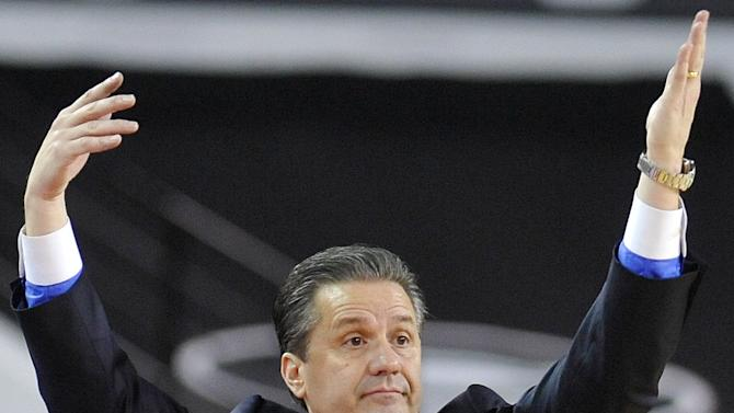 Kentucky head coach John Calipari yells to his team from the sidelines during the first half of an NCAA college basketball game against Georgia in Athens, Ga., Thursday, March 7, 2013. (AP Photo/The Athens Banner-Herald, AJ Reynolds)  MAGAZINES OUT; MANDATORY CREDIT; TV OUT