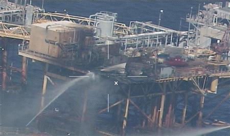 Handout of commercial vessels spraying water to extinguish a platform fire on board an offshore oil platform 20 miles offshore of Grand Isle, Louisiana in the Gulf of Mexico
