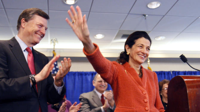 FILE - In this March 2, 2012, file photo Republican Sen. Olympia Snowe, R-Maine, is applauded by her husband, Jock McKernan, left, and others as she waves goodbye at the end of a news conference in South Portland, Maine, where she announced she would not seek a fourth term. Republican Sen. Lisa Murkowski, R-Alaska, (not shown) a moderate in an era of paralyzing partisanship, could be a natural heir to the centrist role played by Snowe at a time when their party is hurting for female leaders. (AP Photo/Robert F. Bukaty, File)