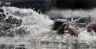 Gold-medalist Oussama Mellouli, from Tunisia, competes in the men's 10-kilometer swimming marathon in Hyde Park at the 2012 Summer Olympics Friday, Aug. 10, 2012, in London. (AP Photo/Charlie Riedel)