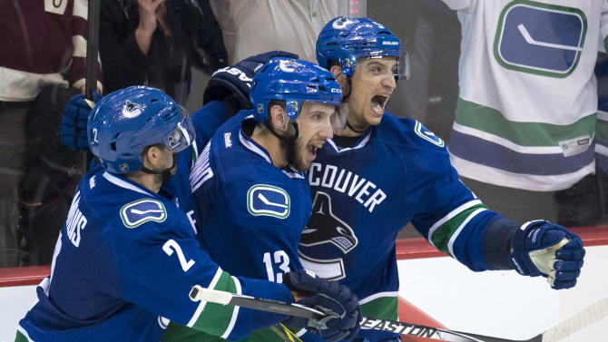 Sbisa scores in overtime, Canucks ground Jets 3-2