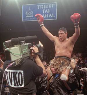"""FILE - This June 22, 1996, file photo shows Hector """"Macho"""" Camacho being lifted into the air after his unanimous decision over Roberto Duran in an IBC middleweight title fight at the Trump Taj Mahal Casino Resort in Atlantic City, N.J. Police in the Puerto Rican city of Bayamon say they found drugs inside the car in which former champion boxer Camacho was shot and critically wounded. Camacho was in critical condition Wednesday, Nov. 21, 2012, at the Centro Medico trauma center in San Juan. (AP Photo/Donna Connor, File)"""