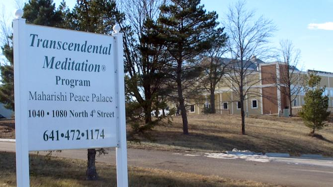 In this Friday, Jan. 18, 2013 photo, a sign advertising its trademark transcendental meditation program stands outside the offices of the Maharishi Foundation in Fairfield, Iowa. The foundation has filed a lawsuit seeking to enforce its trademark rights against a supporter of a rival technique called vedic meditation. (AP Photo/Ryan J. Foley)