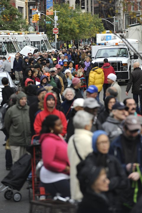A long line of people wait for free distribution of dry ice in Union Square in the still powerless Chelsea section of Manhattan,Thursday, Nov. 1, 2012, in New York. Three days after superstorm Sandy w
