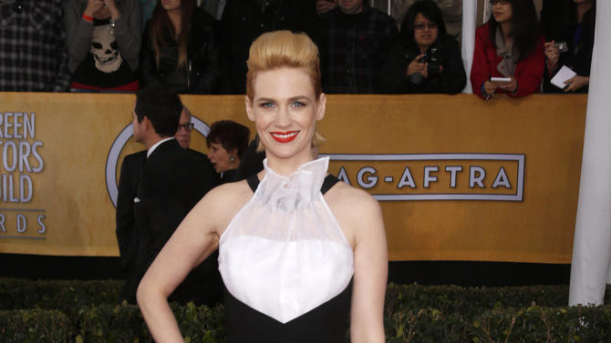 FILE - In this Jan. 27, 2013 file photo, actress January Jones arrives at the 19th Annual Screen Actors Guild Awards at the Shrine Auditorium in Los Angeles.  Jones is wearing a Prabal Gurung gown. Critics both praised and poo-pooed the bold, black and white, structured ensemble. (AP Photo/The Hollywood Reporter, Todd Williamson)