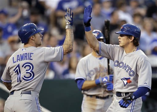 Rasmus hits two homers, Hutchinson wins Jays debut