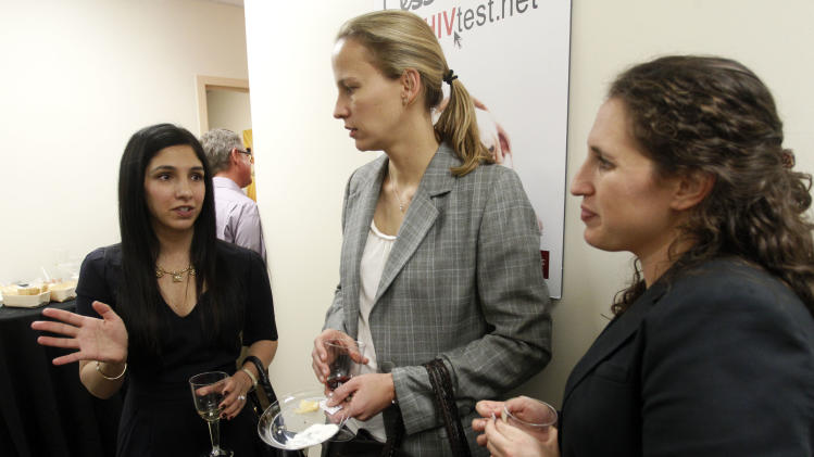 IMAGE DISTRIBUTED FOR AIDS HEALTHCARE FOUNDATION - From left, Dr. Roshini Gandhi, AHF Medical Director of Texas, speaks with Ashley Johnston and Jennifer Gurevitz at the grand opening of the new AHF Healthcare Center in Dallas, TX. Monday, December 3, 2012 in Fort Worth, Texas. (Richard W. Rodriguez/AP Images for AIDS Healthcare Foundation)