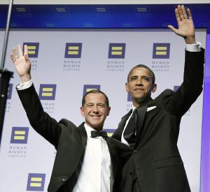 RETRANSMISSION TO CORRECT SPELLING OF NAME - President Barack Obama, right, and President of the Human Rights Campaign Joe Solmonese greet guests at the Human Rights Campaign's 15th annual national dinner in Washington Saturday Oct. 1, 2011. (AP Photo/Manuel Balce Ceneta)