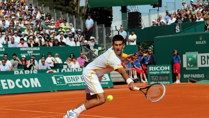 Novak Djokovic of Serbia plays a return to Spain's Rafael Nadal, during their final match of the Monte Carlo Tennis Masters tournament in Monaco, Sunday, April 21, 2013. (AP Photo/Claude Paris)