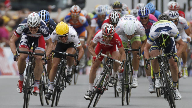 Stage winner Andre Greipel of Germany, left, Mark Cavendish of Britain, Samuel Dumoulin of France, Tom Veelers of The Netherlands, and Matthew Harley Gross of Australia, from left to right, sprint towards the finish line of the fifth stage of the Tour de France cycling race over 196.5 kilometers (122 miles) with start in Rouen and finish in Saint-Quentin, France, Thursday July 5, 2012. (AP Photo/Laurent Rebours)