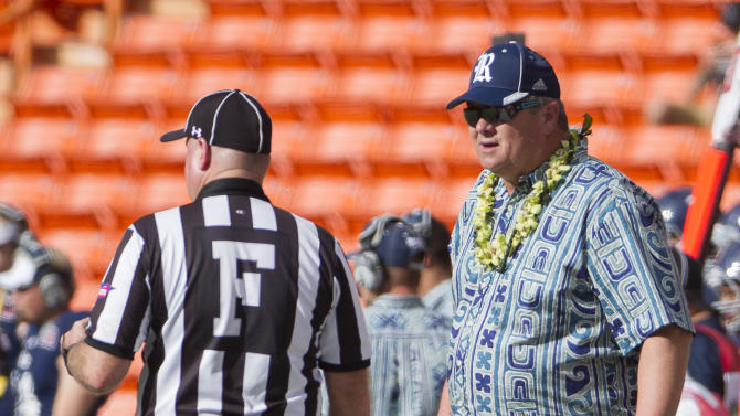 Rice head coach David Bailiff, right, talks to an official while his team takes on Fresno State in the first quarter of the Hawaii Bowl NCAA college football game, Wednesday, Dec. 24, 2014, in Honolulu. (AP Photo/Eugene Tanner)