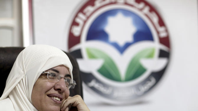 In this Wednesday, Oct. 9, 2012 photo, Azza el-Gharf of the Muslim Brotherhood's Freedom and Justice Party speaks to the Associated Press at the party's office in Cairo, Egypt. El-Garf, a 47-year-old mother of seven who joined the Brotherhood when she was 15, said that a woman's role in her family need not contradict with her participation in politics, saying that she balances these two responsibilities. The rise of the Muslim Brotherhood to power in Egypt has brought with it a new group of female politicians who say they are determined to bring more women into leadership roles _ and at the same time want to consecrate a deeply conservative Islamic vision for women in Egypt.(AP Photo/Maya Alleruzzo)