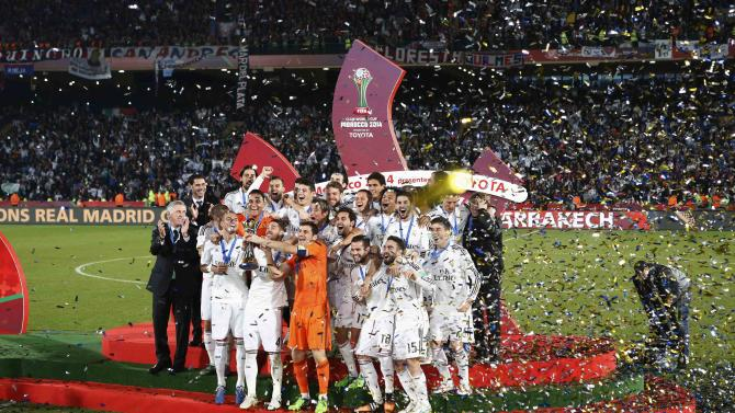 Real Madrid players celebrate winning the Club World Cup final soccer match against San Lorenzo at Marrakesh
