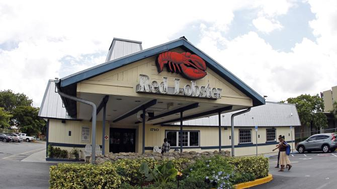 FILE - This Thursday, Sept. 6, 2012, file photo, shows a Red Lobster restaurant in Hialeah, Fla. After new ad campaigns touting the quality of its food failed to spark sales, Darden Restaurants, the parent company of Olive Garden and Red Lobster is retooling its strategy to attract diners with more promotional deals. (AP Photo/Alan Diaz, File)