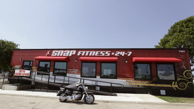 This June 14, 2012, photo shows a Snap Fitness truck stop gym in Dallas. From trucking companies embracing wellness and weight-loss programs to gyms being installed at truck stops, momentum has picked up in recent years to help those who make their living driving big rigs get into shape. (AP Photo/LM Otero)