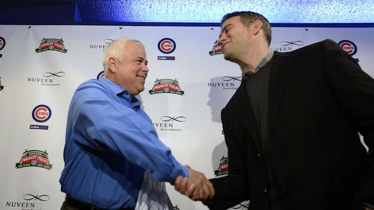 New Chicago Cubs manager Rick Renteria, left, shakes hands with Chicago Cubs president of baseball operations Theo Epstein, right, during a news conference at Wrigley Field in Chicago, Thursday, Dec., 5, 2013. Renteria met with members of the media for the first time since he was hired last month, while recuperating in San Diego from hip surgery