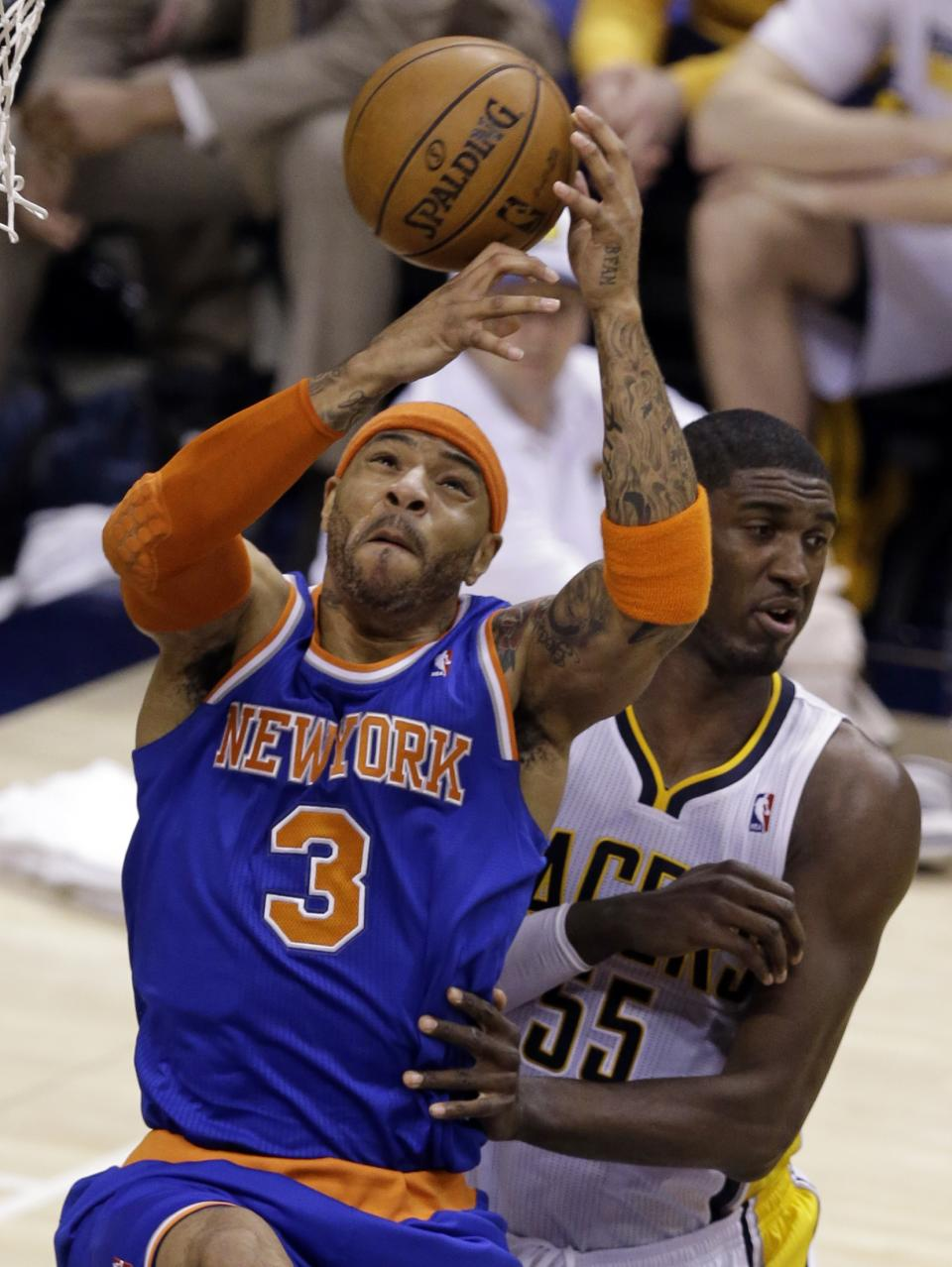 New York Knicks forward Kenyon Martin, right, grabs a rebound in front of Indiana Pacers center Roy Hibbert during the first half of Game 3 of the Eastern Conference semifinal NBA basketball playoff series in Indianapolis, Saturday, May 11, 2013.  (AP Photo/Michael Conroy)